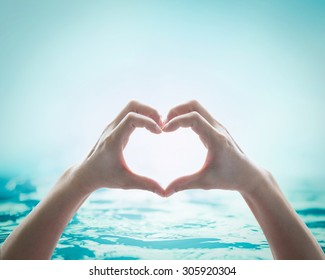 Hands in love heart shape for friendship and saving water and ocean concept