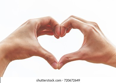Hands made heart on white background