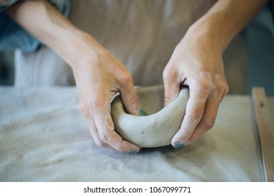 Hands make clay from various items for home and sale in the store and at the exhibition, ceramic items are made in hand, the clay billet becomes a ceramic dish, the ceramic master sculpts a beautiful