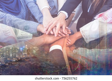 Hands make light work. Asian business team join hand hug with arab people to work business together. Muslim group created teamwork for fight in world business. All people work hard for big success.