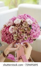Hands making beautiful bouquet