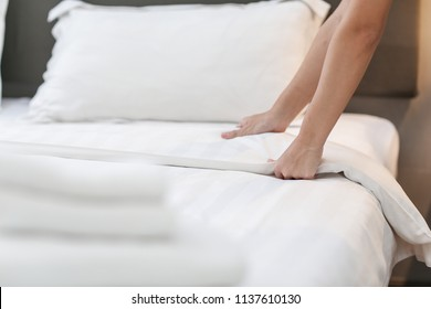 Hands Making Bed from Hotel Room Service
