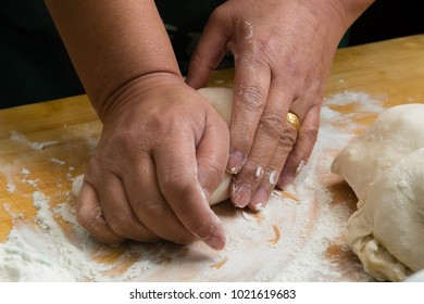 hands making the dough closeup view