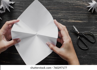Hands making origami Christmas tree