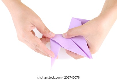 Hands making origami toy, close up, isolated on white