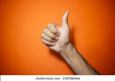 Hands making positive symbols with colourful background