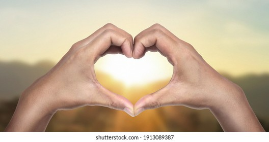 Hands making sign Heart isolated. Beautiful hands  with copy space. Love concept on Valentine day