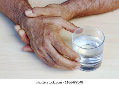 The hands of a man with Parkinson's disease tremble. Strongly trembling hands of an older man