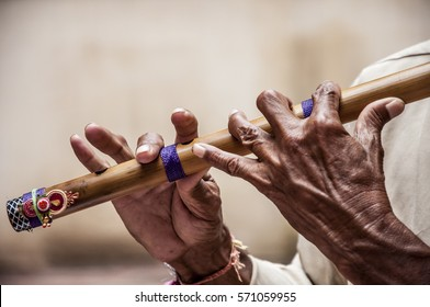 Hands of a man playing a flute / Perfect hands / the magic sound of India