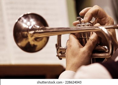 Hands of the man playing the trumpet
