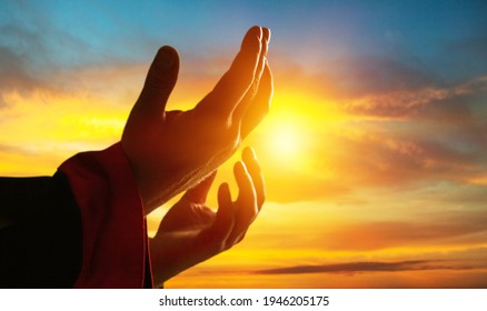 Hands of man praying for thank god outdoor