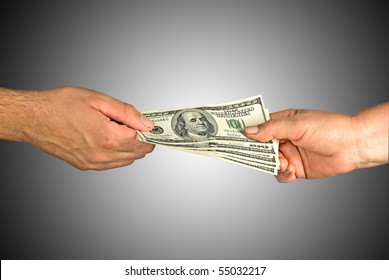 Hands of man and woman  with dollars