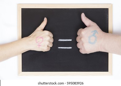 Hands of man and woman representing gender equality on a blackboard