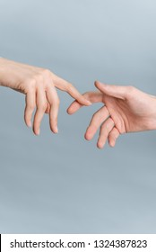 Hands of man and woman touching to each other, people relationship