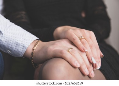 Hands of a man and a woman with wedding gold rings. The concept of love, family life, support. The relationship between a man and a woman
