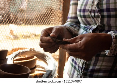 Hands of married woman kneading clay clay in her hands to make figure