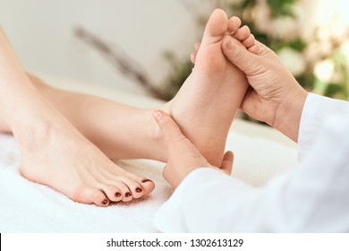 hands massage the foot relax