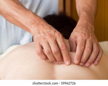 the hands of a massage that applies a massage