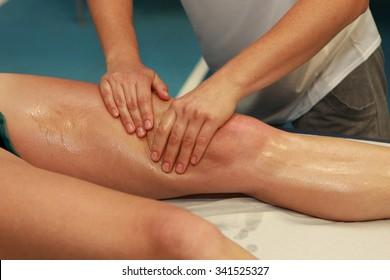 hands massaging athlete's thigh after running