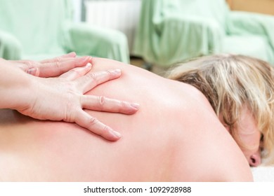 Hands massaging the back, lying on the belly of a woman
