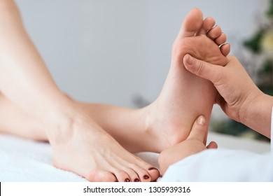 hands massaging feet pedicure