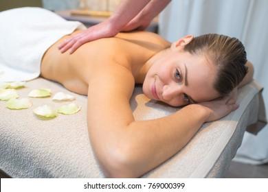 hands massaging female back