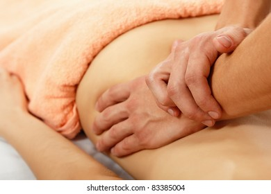 hands of masseur massaging woman young beautiful