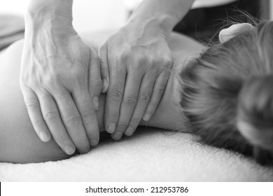 Hands of masseur, monochrome