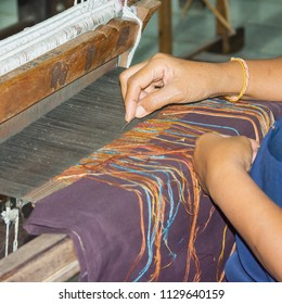 Hands of  master, production of a tapestry on primitive machine tool