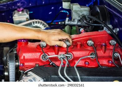 hands of mechanic working in auto repair shop