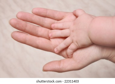 Hands of mother and the child