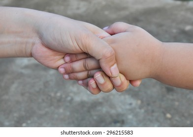 hands of mother and child closeup