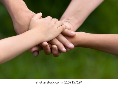 hands of mother, father and children together, family and teamwork concept