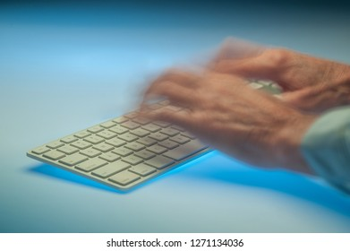 Hands in motion typing on a keyboard