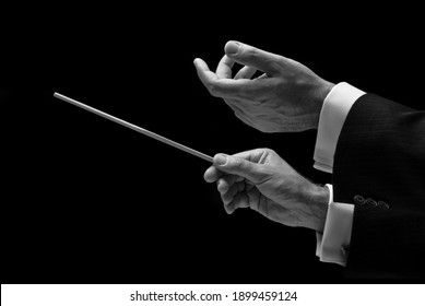 The hands of a music conductor