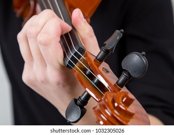 hands of a musician on a violin, for a melody