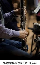 Hands musician playing bass clarinet