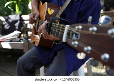 hands of musician playing guitar