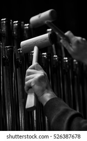 Hands musician playing the orchestral bells closeup in black and white