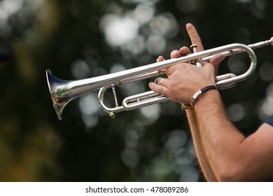Hands of the musician playing a trumpet