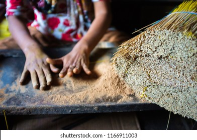 Hands of a Muslim girl making home made incense sticks in Mysore, India