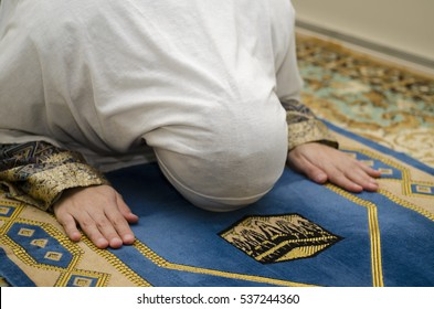Hands of muslim woman on the carpet praying in traditional wearing clothes, Woman in Hijab, Carpet of Kaaba, Blurred lens, toned