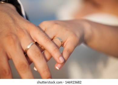 Hands of a newlywed couple