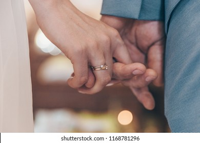 hands of newlyweds with rings. Newly wed couple's hands with wedding rings