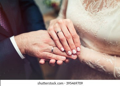 Hands newlyweds with wedding rings close up