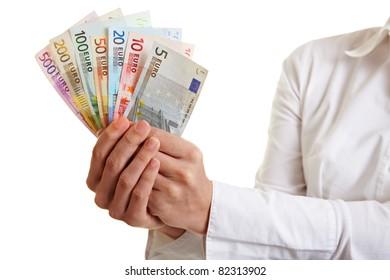 Hands offering fan of Euro money bills
