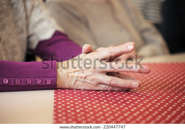 Hands of an old lady.