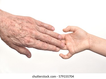 Hands of  old man and child