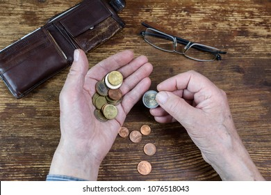 Hands of an old man counting money, Euro.  The concept of poverty, austerity, savings in old age.