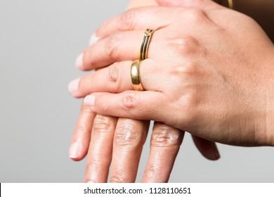 hands of an older woman using skin cream